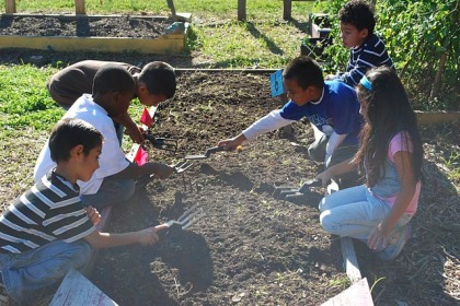 Children Cleaning Out a Garden Bed